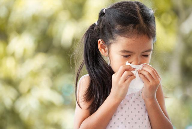 Allergies: Girl Sneezing