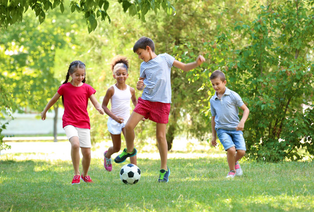 Kids Playing Soccer Outdoors